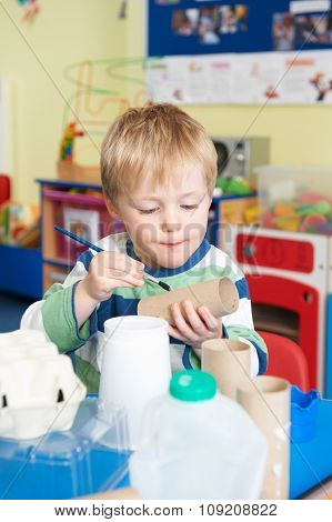 Boy Building Junk Model In Pre School Class