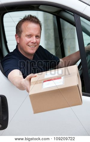 Courier Sitting In Van Delivering Package