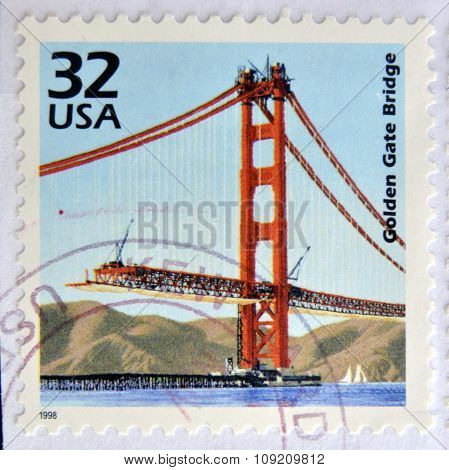 a stamp printed in USA showing an image of a the Golden Gate bridge construction