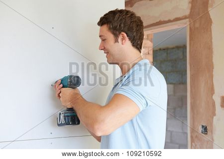 Builder Using Power Tool On Site