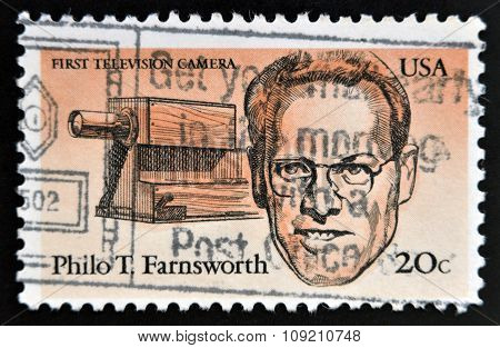 stamp printed in USA shows first television camera and portrait of Philo T. Farnsworth (1906-1971)