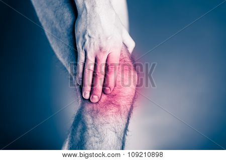 Knee pain physical injury. Male leg and muscle pain from running or training sport physical injuries