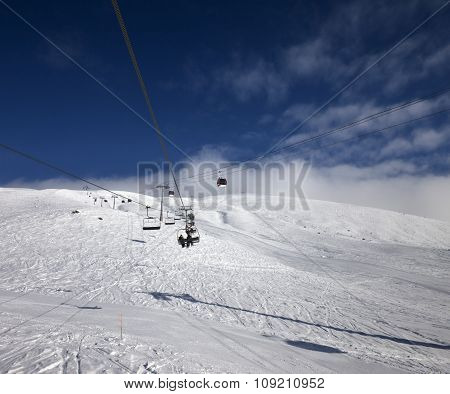 Gondola And Chair Lift At Ski Resort In Nice Day