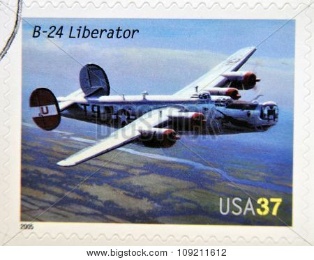 A stamp printed in USA dedicated to advances in aviation shows Consolidated B-24 Liberator