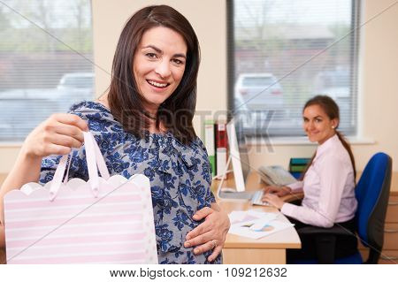 Pregnant Businesswoman Going On Maternity Leave From Office