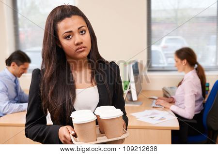 Fed Up Female Intern Fetching Coffee In Office
