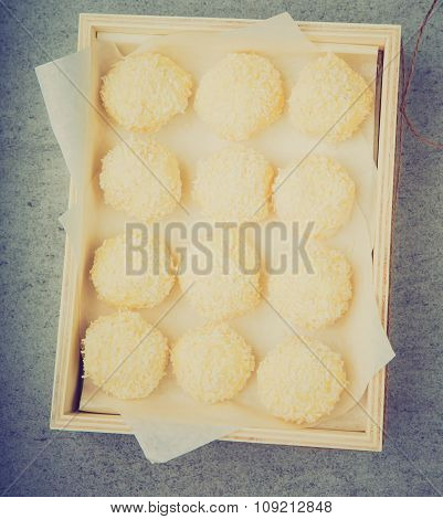 Vintage Photo Of Homemade Coconut Pralines In A Wooden Box