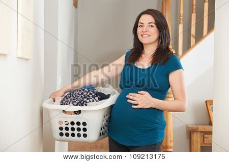 Pregnant Woman Doing Chores At Home