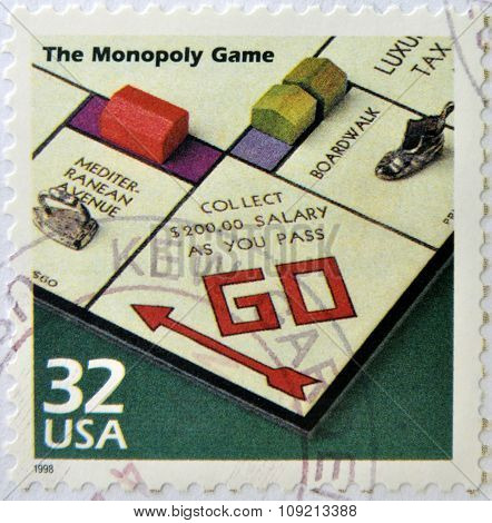 a stamp printed in USA showing an image of monopoly game circa 1998.