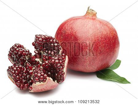 External and internal surfaces of  pomegranate with leaf isolated on white background.