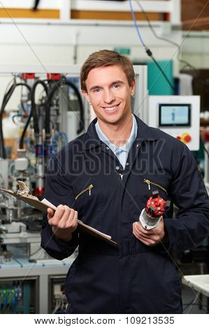 Engineer Checking Component In Factory