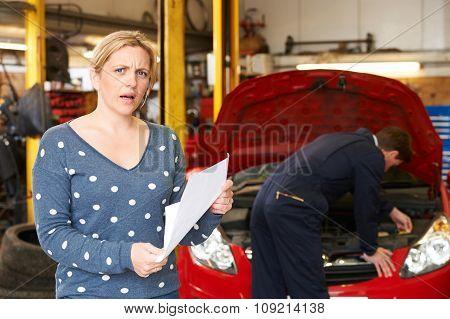 Shocked Customer Looking At Garage Bill