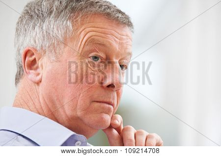 Thoughtful Senior Man At Home