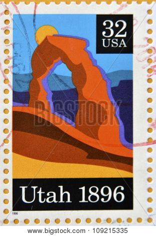 A stamp printed in USA shows Delicate Arch Arches National Park Utah circa 1996