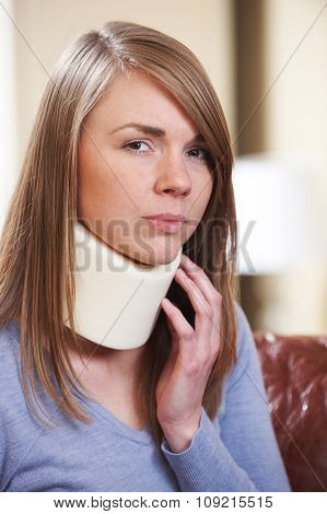 Woman In Pain Wearing Neck Brace