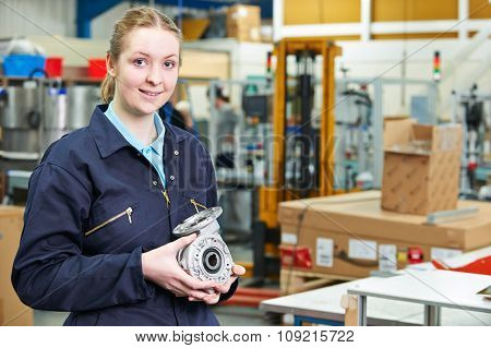 Portrait Of Female Apprentice Holding Component