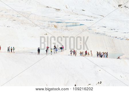 Pamukkale, Turkey - August, 14 2015: Tourists on Pamukkale Travertine pools and terraces. Pamukkale is famous UNESCO world heritage site in Turkey