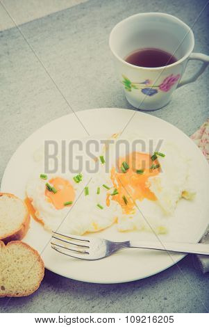 Vintage Photo Of Two Fried Eggs With Chives On Plate