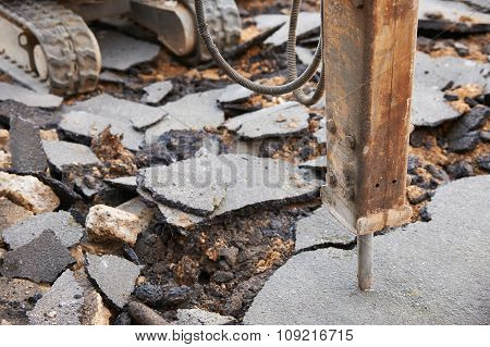 Close Up Of Jackhammer Breaking Up Road Surface