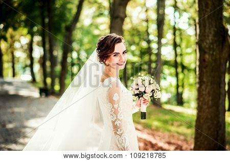 Portrait Of Young Bride With Bouquet Of Flowers
