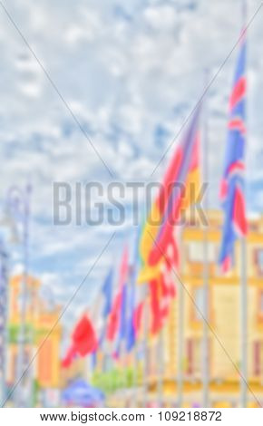 Defocused Background With Flags Of European Countries Against A Cloudy Sky