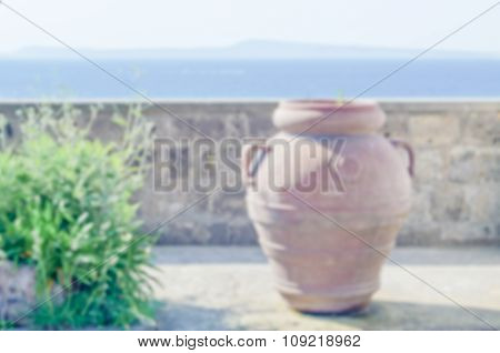 Defocused Background Of Terracotta Vase Against A Mediterranean Panorama