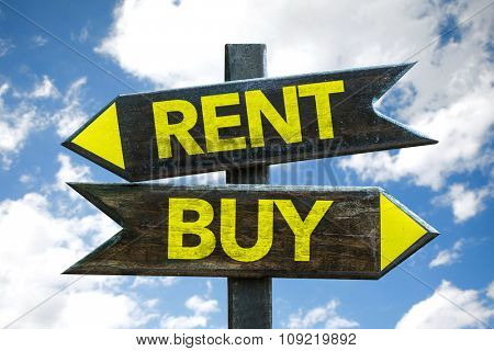 Rent - Buy signpost with sky background