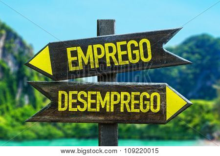 Employment - Unemployment (in Portuguese) signpost in a beach background