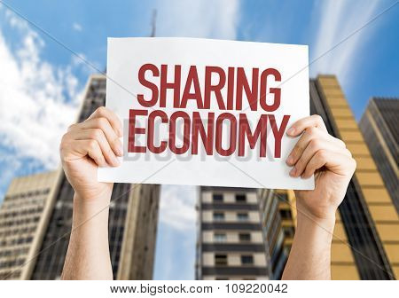 Sharing Economy placard with urban background