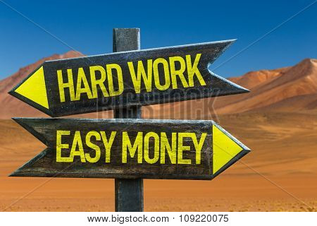 Hard Work - Easy Money signpost in a desert background