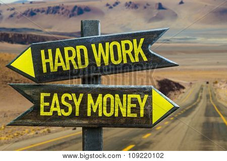 Hard Work - Easy Money signpost in a desert road on background