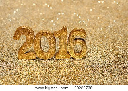 Golden 2016 new years numbers on gold background