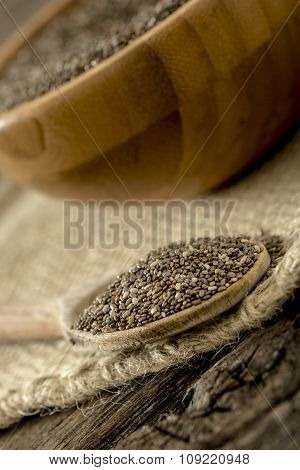 Closeup Of Wooden Spoon Full Of Healthy Organic Chia Seeds