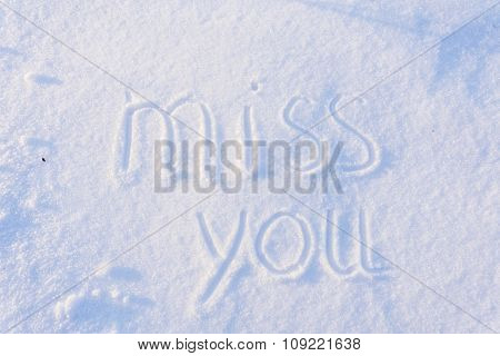 Miss you written on snow