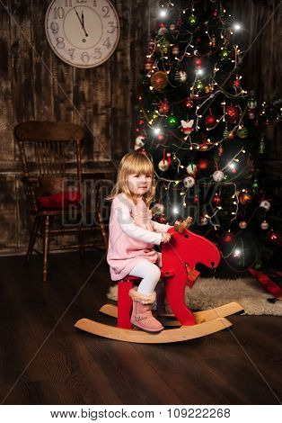Little Girl On A Toy Horse