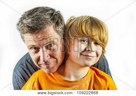 Father And Happy Son Hugging