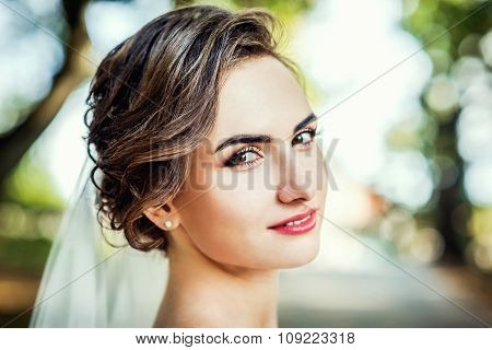 Closeup Portrait Of Young Bride In The Park