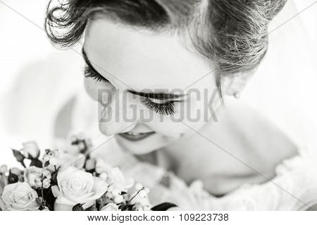 Closeup Portrait Of Young Bride With Bouquet Of Flowers