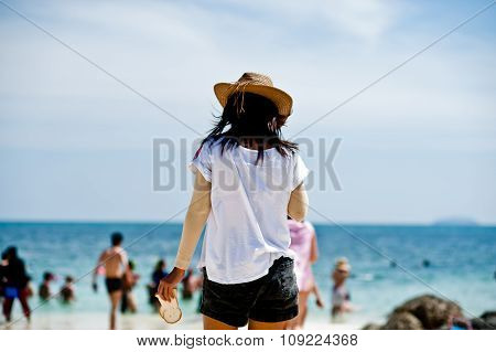 Tourists Relax On The Beach In Phuket Thailand