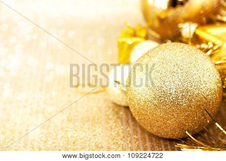 Golden Christmas Decorations On Shiny Background With Copy Space For Text. Christmas Background Or G