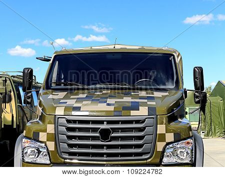 MOSCOW REGION  -   JUNE 17: Front view of heavy army truck with camouflage masking coloration -  on June 17, 2015 in Moscow region