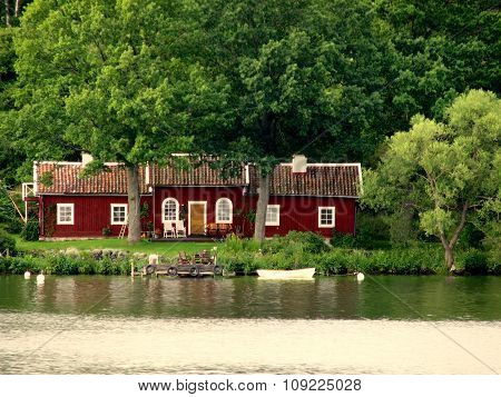 Red Lakeside Cottage