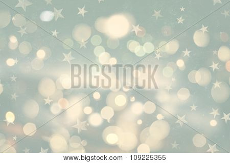 Retro styled Christmas background with bokeh lights and stars
