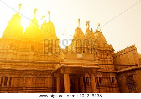 Ancient sandstone made Hindu Temple inside Golden fort of Jaisalmer, Rajasthan, India with beautiful sunset.