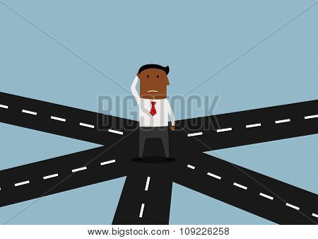 Businessman standing and thinking on crossroad