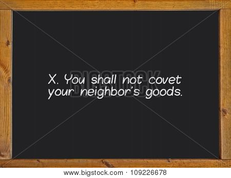 The tenth commandment of christian catholic on a blackboard