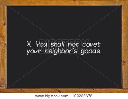 The tenth commandment of christian catholic on a blackboard
