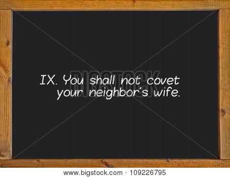 The ninth commandment of christian catholic on a blackboard