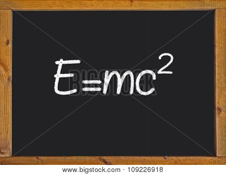 Theory of relativity (E=mc2) written on a chalkboard