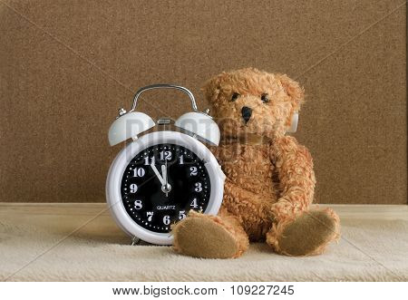 Teddy Bear With Alarm Clock On Wooden